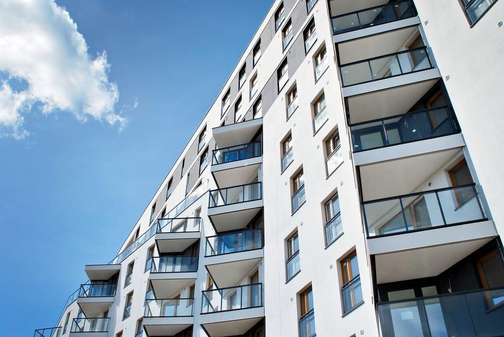 A condo building against a blue sky. Condos require HO-6 insurance!