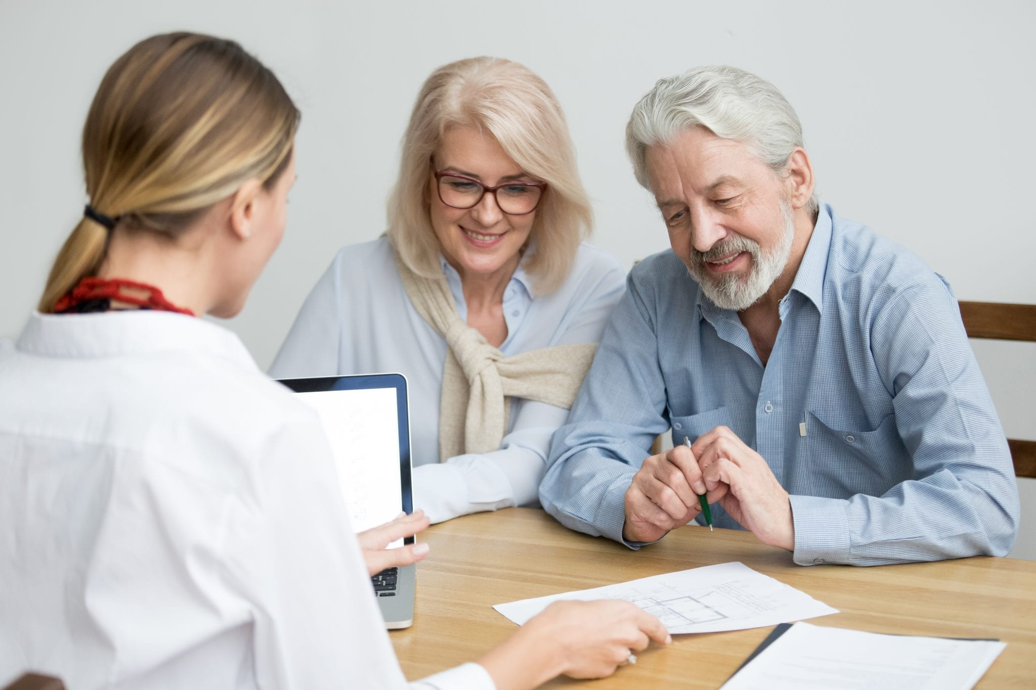 Older couple meeting with real estate agent about quitclaim deed.