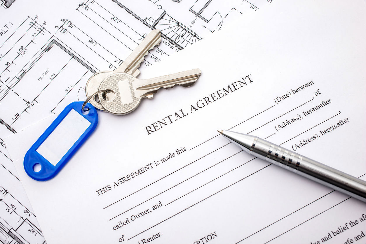 A rental agreement with keys on top