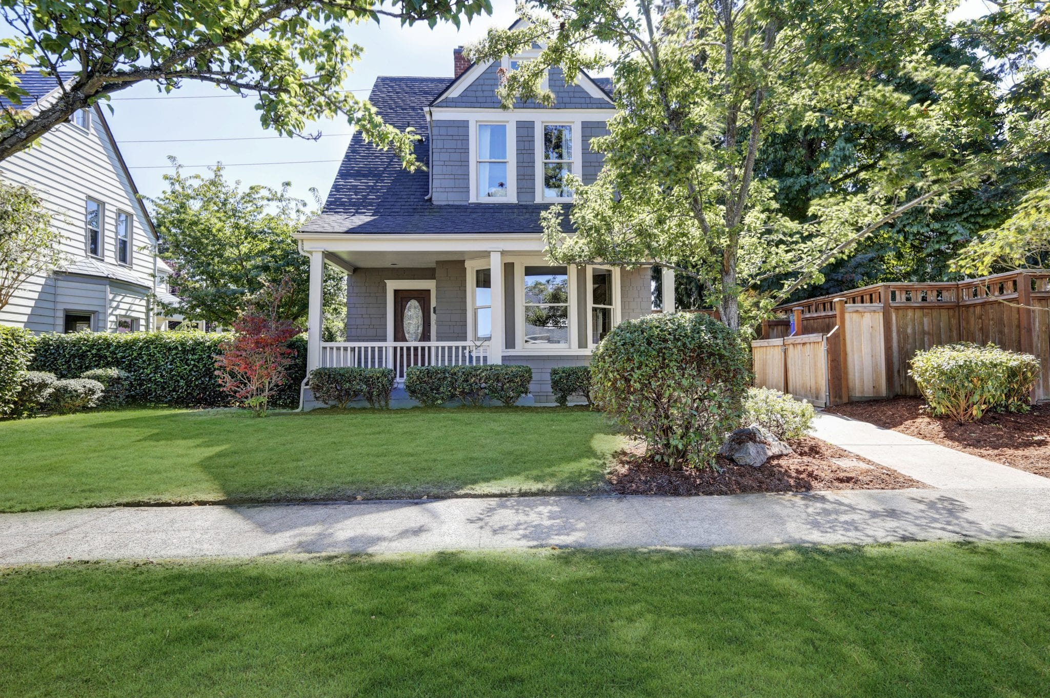 American front house with well-kept front yard and beautiful curb appeal.