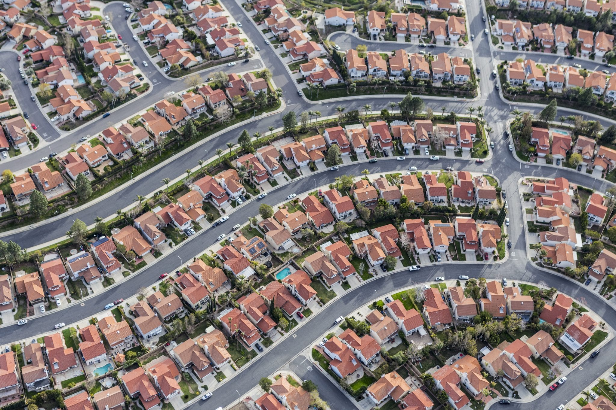 Aerial view of a neighborhood. Neighborhoods often have an HOA.