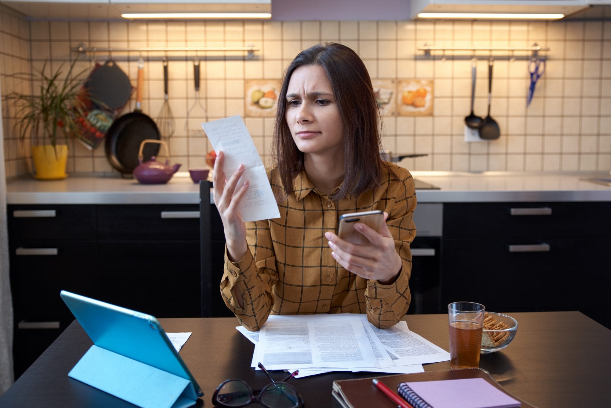 Woman looking at bills trying to figure out