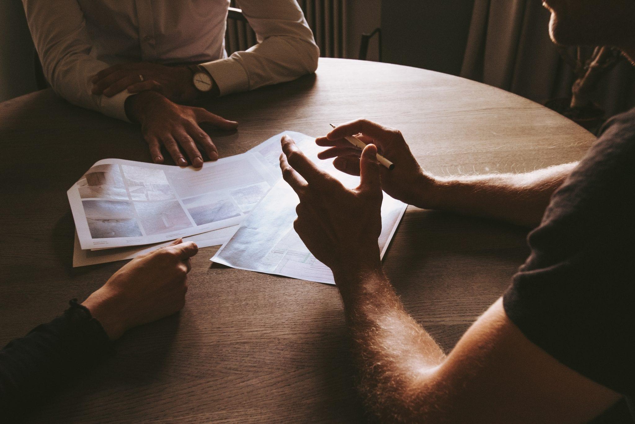 transaction broker meeting at table