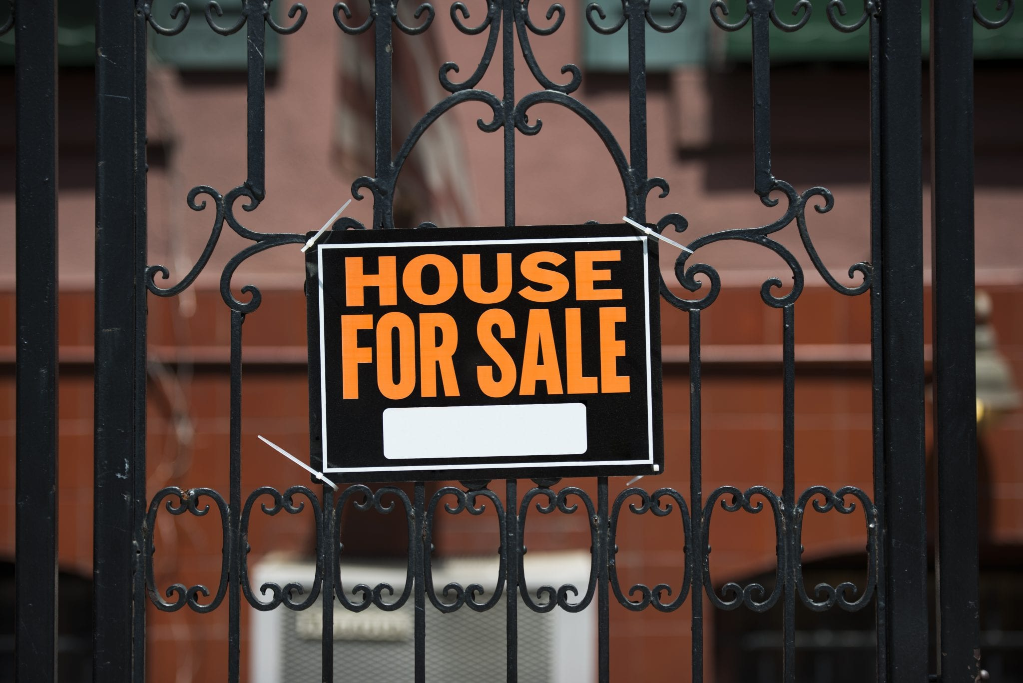 House for sale sign. Here's how to sell your house when you aren't getting any offers.